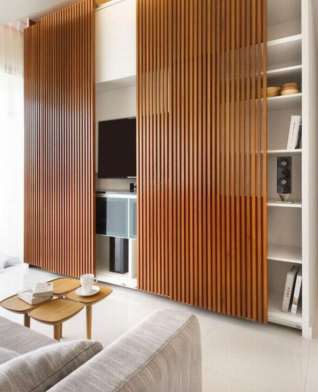 jak ukryć telewizor w salonie ukryty telewizor we wnętrzu w domu inspiracje design pomysły rozwiązania 23