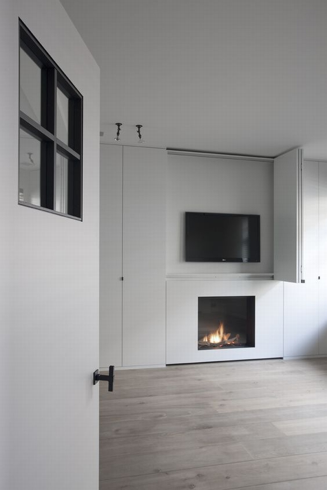jak ukryć telewizor w salonie ukryty telewizor we wnętrzu w domu inspiracje design pomysły rozwiązania 26