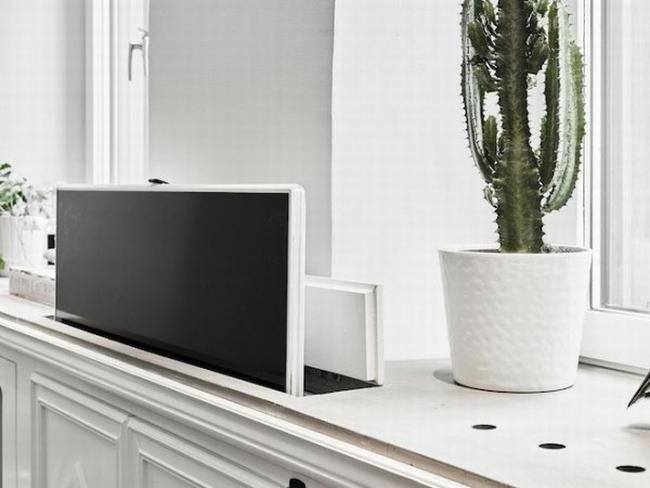 jak ukryć telewizor w salonie ukryty telewizor we wnętrzu w domu inspiracje design pomysły rozwiązania 31